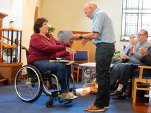 "Jane presents Geoff a ""Child Friendly Church"" Award for Newport Pangnell"