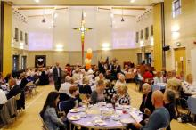The church and Halls transformed into a large dining room looking north to the sanctuary.