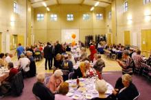 The church and Halls transformed into a large dining room looking south from the sanctuary.